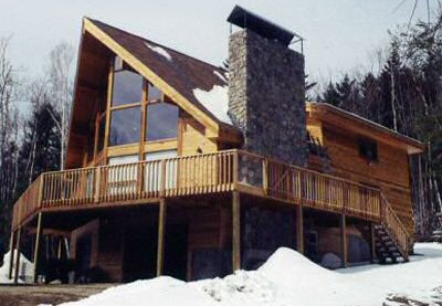 Log home with a Stone Fireplace